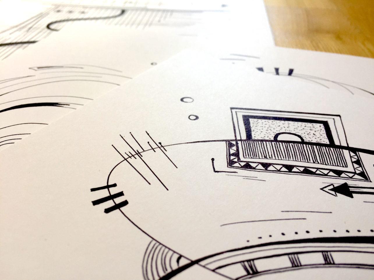 Détail des dessins faits au stylo noir sur fond blanc